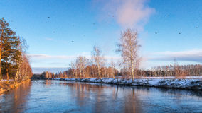 Spring landscape on the river at sunset and a flock of birds, Russia, Ural Stock Photos