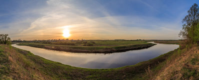 Spring landscape, rivers turn near the village. The setting sun Stock Images