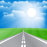Spring landscape with road and sun. Royalty Free Stock Images