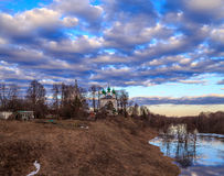 Spring landscape, sky, clouds, temple. On the bank of the river flooded Royalty Free Stock Images