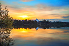 Spring landscape with sunrise over water Stock Photography