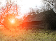 Spring landscape at sunset, old wooden house Stock Photography