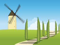 Spring landscape with trees and a windmill stock photo