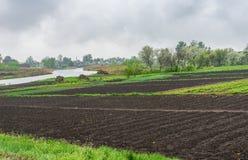 Spring landscape with vegetable gardens on a bank of Kotelva river Stock Images