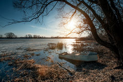Spring landscape with wooden boat Royalty Free Stock Photography