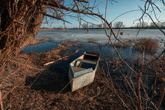 Spring landscape with wooden boat Royalty Free Stock Images
