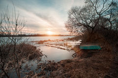 Spring landscape with wooden boat Royalty Free Stock Photo