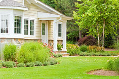 Spring landscaping home. A view of landscaping in the backyard of a country home in the springtime Stock Photos