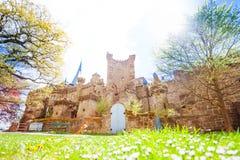 Spring lawn and Lowenburg castle, Kassel Bergpark Stock Photo