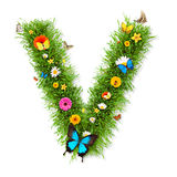 Spring letter V. Fresh grass spring letter V with blooming flowers and butterflies, isolated on white background stock illustration
