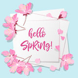Spring lettering. Blossoming tree brunch with spring flowers on blue background. Vector illustration. Royalty Free Stock Photos