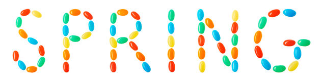 Spring lettering made of multicolored candies isolated on white Stock Photography