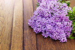 Spring lilac flower on old wooden background Royalty Free Stock Image