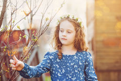 Spring little girl with a butterfly on his finger. Royalty Free Stock Images