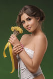 Spring look of young beautiful woman with flowers Stock Photos