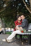Spring. Love. bench. Young couple embracing on a bench stock photography