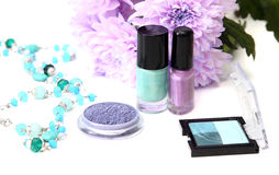 Spring make-up and cosmetics - nail polishes, shadow. With flowers Royalty Free Stock Image