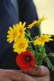 Spring-Mature woman with flowers. Yellow and red Royalty Free Stock Photo