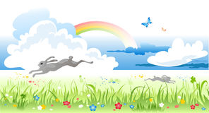Spring meadow. With rainbow and bunny Stock Photo