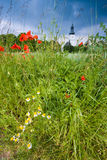 Spring meadow with church Royalty Free Stock Images