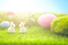 Spring meadow with miniature easter rabbits and easter eggs Royalty Free Stock Photos
