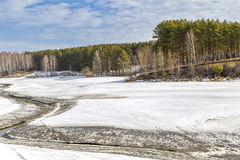 Spring melting of ice on the river. Siberia, Russia Stock Images