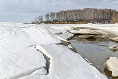 Spring melting of ice on the river. Siberia, Russia Stock Photos