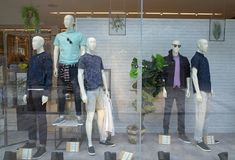 Spring Menswear Window Display in the Next Store in Bracknell, England. Bracknell, England - April 23, 2018: Window display of Spring fashion clothing for men in Stock Photos