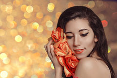Spring model shooting. Woman with flowers roses. Fashion makeup. Royalty Free Stock Images