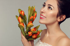Spring model shooting. Young woman with flowers tulips. Fashion Stock Photography
