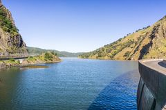 In the spring of 2017 Monticello Dam is full and the famous 'Glory Hole ' spillway is running again after record rainfall, Lake. Berryessa, Napa Valley royalty free stock image