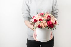 Beautiful luxury bouquet of mixed flowers in woman hand. the work of the florist at a flower shop. Horizontal photo. Spring mood. beautiful luxury bouquet of royalty free stock image