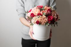 Beautiful luxury bouquet of mixed flowers in woman hand. the work of the florist at a flower shop. Horizontal photo. Spring mood. beautiful luxury bouquet of stock image