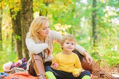 Spring mood. Happy family day. Happy son with mother relax in autumn forest. Mother love her small boy child. Sunny. Weather. Healthy food. Family picnic royalty free stock photography