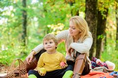 Spring mood. Happy family day. Happy son with mother relax in autumn forest. Mother love her small boy child. Sunny. Weather. Healthy food. Family picnic royalty free stock photos