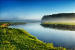 Morning. dawn near a picturesque river Royalty Free Stock Photo