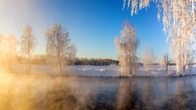 Spring morning landscape with fog and a forest on the shore of a lake, Russia, the Urals, February Royalty Free Stock Images