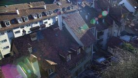 Spring morning in small European town, view on tile roofs, good weather. Stock footage stock video