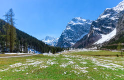 Spring mountain landscape with patches of melting snow, Austria, Tyrol, Karwendel Alpine Park. Spring mountain landscape with patches of melting snow. Austria Royalty Free Stock Photography