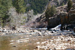 Spring mountain river. Slow flowing river fed from snow melting run off stock image