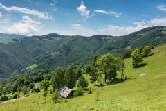 Spring mountains with old wooden chalet Royalty Free Stock Photos