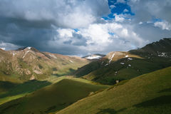 Spring mountains with snow and cloudy sky Royalty Free Stock Photo