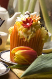 Spring muffins decorated with flower stock image