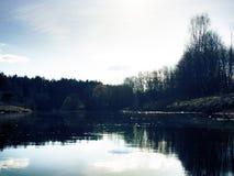 Spring narrow river among meadows and coppices stock photos
