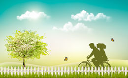 Spring nature meadow landscape with a bicycle and silhouette. Royalty Free Stock Image