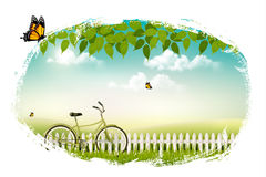 Spring nature meadow landscape with a bicycle. Stock Image