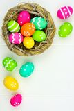 Spring nest with Easter Eggs against white wood Royalty Free Stock Photo