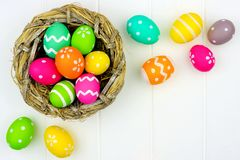 Spring nest with Easter Eggs against white wood Royalty Free Stock Image