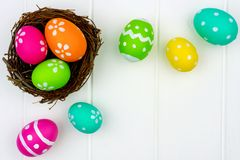 Spring nest with Easter Eggs against white wood Royalty Free Stock Photos