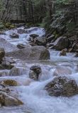 Spring in New Hampshire. As snow melts at the White Mountains, water level raises in the rivers creating continuous mini waterfalls flow hampshire hiking new stock photography